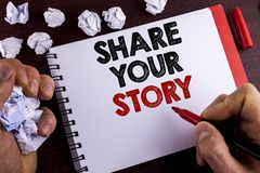 Conceptual hand writing showing Share Your Story. Business photo text Tell personal experiences talk about yourself Storytelling w. Ritten by Man Notepad wooden Royalty Free Stock Photography