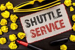 Conceptual hand writing showing Shuttle Service. Business photo text Transportation Offer Vacational Travel Tourism Vehicle writte. N Cardboard Piece the wooden Royalty Free Stock Photos