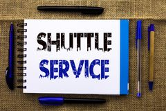 Conceptual hand writing showing Shuttle Service. Business photo text Transportation Offer Vacational Travel Tourism Vehicle writte. N Notebook Book the jute Stock Photos