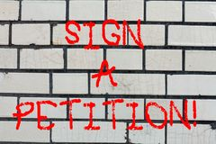 Conceptual hand writing showing Sign A Petition. Business photo text Support a cause by signing paper with an agreement. Brick Wall art like Graffiti royalty free stock photo