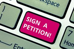 Conceptual hand writing showing Sign A Petition. Business photo text Support a cause by signing paper with an agreement. Keyboard key Intention to create stock image