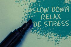 Conceptual hand writing showing Slow Down Relax De Stress. Business photo showcasing Have a break reduce stress levels. Rest calm Sprinkle blue color on floor stock images