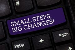 Conceptual hand writing showing Small Steps Big Changes. Business photo text Make little things to accomplish great. Goals Keyboard key Intention to create stock photography