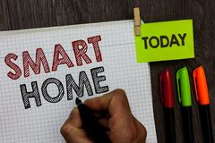 Conceptual hand writing showing Smart Home. Business photo text automation system control lighting climate entertainment systems M. An holding marker notebook royalty free stock image