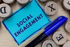 Conceptual hand writing showing Social Engagement. Business photo text Degree of engagement in an online community or society.  stock photo