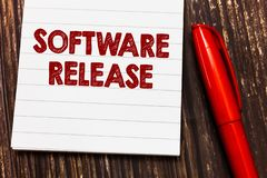 Conceptual hand writing showing Software Release. Business photo showcasing sum of stages of development and maturity. For program stock image