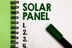 Conceptual hand writing showing Solar Panel. Business photo showcasing designed to absorb suns rays source of energy generating Ma. Rker over notebook white page stock images