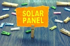 Conceptual hand writing showing Solar Panel. Business photo text designed to absorb suns rays source of energy generating Clothesp. In holding orange paper note stock images