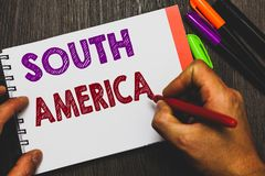 Conceptual hand writing showing South America. Business photo text Continent in Western Hemisphere Latinos known for Carnivals Man. Holding notebook paper royalty free stock photos