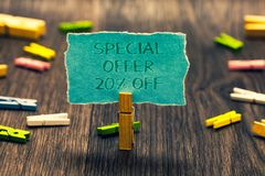 Conceptual hand writing showing Special Offer 20 Off. Business photo showcasing Discounts promotion Sales Retail Marketing Offer P. Aperclip retain blue stock photo