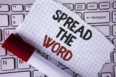 Conceptual hand writing showing Spread The Word. Business photo text Run advertisements to increase store sales many fold written. Tear Notebook paper placed royalty free stock images