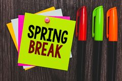 Conceptual hand writing showing Spring Break. Business photo showcasing Vacation period at school and universities during spring P. Aper notes Communicate ideas royalty free stock images