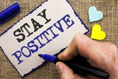 Conceptual hand writing showing Stay Positive. Business photo showcasing Be Optimistic Motivated Good Attitude Inspired Hopeful wr. Itten Sticky Note the jute Stock Photo