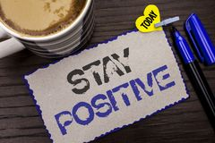 Conceptual hand writing showing Stay Positive. Business photo showcasing Be Optimistic Motivated Good Attitude Inspired Hopeful wr. Itten Sticky Note wooden Stock Photos