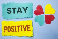 Conceptual hand writing showing Stay Positive. Business photo showcasing Be Optimistic Motivated Good Attitude Inspired Hopeful wr. Itten Tear Papers the Sky Royalty Free Stock Photo