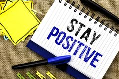 Conceptual hand writing showing Stay Positive. Business photo showcasing Be Optimistic Motivated Good Attitude Inspired Hopeful wr. Itten Notebook Book the jute stock photo