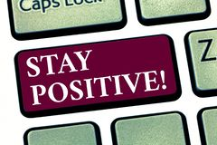 Conceptual hand writing showing Stay Positive. Business photo showcasing Be Optimistic Motivated Good Attitude Inspired. Hopeful Keyboard key Intention to royalty free stock images