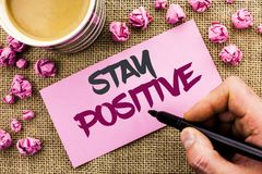 Conceptual hand writing showing Stay Positive. Business photo text Be Optimistic Motivated Good Attitude Inspired Hopeful written. By Man Holding Marker Paper Royalty Free Stock Image