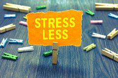 Conceptual hand writing showing Stress Less. Business photo text Stay away from problems Go out Unwind Meditate Indulge Oneself Cl. Othespin holding orange paper stock images