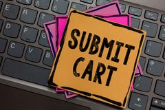 Conceptual hand writing showing Submit Cart. Business photo showcasing Sending shopping list of online items Proceed checkout Pape. Rs keyboard Inspiration royalty free stock photography