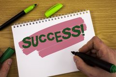 Conceptual hand writing showing Success Motivational Call. Business photo text Achievement Accomplishment of some purpose written. By Man Notepad holding Marker Royalty Free Stock Image