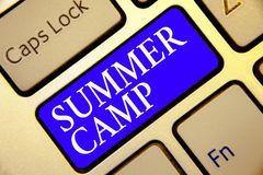 Conceptual hand writing showing Summer Camp. Business photo showcasing Supervised program for kids and teenagers during summertime. Keyboard blue key Intention stock photo