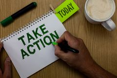 Conceptual hand writing showing Take Action. Business photo showcasing advices someone to do something or reaction right now Man h. Olding marker notebook royalty free stock photo