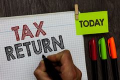 Conceptual hand writing showing Tax Return. Business photo text which taxpayer makes annual statement of income circumstances Man. Holding marker notebook stock photos