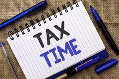 Conceptual hand writing showing Tax Time. Business photo showcasing Taxation Deadline Finance Pay Accounting Payment Income Revenu. E written Notebook Book jute Royalty Free Stock Photos