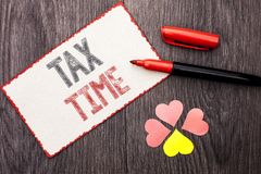 Conceptual hand writing showing Tax Time. Business photo text Taxation Deadline Finance Pay Accounting Payment Income Revenue writ. Ten Cardboard Piece With Stock Photography