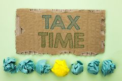 Conceptual hand writing showing Tax Time. Business photo text Taxation Deadline Finance Pay Accounting Payment Income Revenue writ. Ten Tear Cardboard plain Stock Image