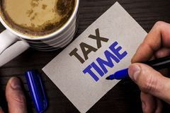 Conceptual hand writing showing Tax Time. Business photo text Taxation Deadline Finance Pay Accounting Payment Income Revenue writ. Ten Man Holding Marker Note Stock Photos