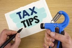 Conceptual hand writing showing Tax Tips. Business photo showcasing Help Ideas for taxation Increasing Earnings Reduction on expen. Ses royalty free stock photo