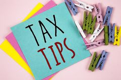 Conceptual hand writing showing Tax Tips. Business photo showcasing Help Ideas for taxation Increasing Earnings Reduction on expen. Ses Stock Photography