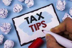 Conceptual hand writing showing Tax Tips. Business photo text Help Ideas for taxation Increasing Earnings Reduction on expenses Co. Conceptual hand writing stock image