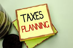 Conceptual hand writing showing Taxes Planning. Business photo showcasing Financial Planification Taxation Business Payments Prepa. Red written Sticky Note Paper Royalty Free Stock Photography
