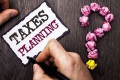 Conceptual hand writing showing Taxes Planning. Business photo text Financial Planification Taxation Business Payments Prepared wr. Itten by Man Sticky Note Royalty Free Stock Image