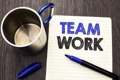 Conceptual hand writing showing Team Work. Business photo showcasing Cooperation Together Group Work Achievement Unity Collaborati. On written Notebook Paper royalty free stock images