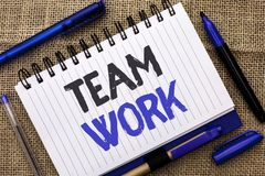 Conceptual hand writing showing Team Work. Business photo showcasing Cooperation Together Group Work Achievement Unity Collaborati. On written Notebook Book jute royalty free stock image