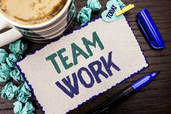 Conceptual hand writing showing Team Work. Business photo showcasing Cooperation Together Group Work Achievement Unity Collaborati. On written Cardboard Piece stock photography