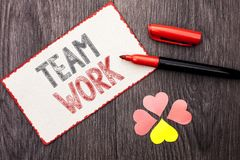 Conceptual hand writing showing Team Work. Business photo text Cooperation Together Group Work Achievement Unity Collaboration wri. Tten Cardboard Piece With royalty free stock image