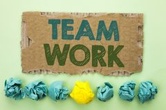 Conceptual hand writing showing Team Work. Business photo text Cooperation Together Group Work Achievement Unity Collaboration wri. Tten Tear Cardboard plain royalty free stock photo