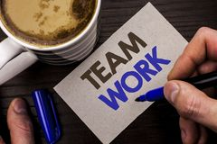 Conceptual hand writing showing Team Work. Business photo text Cooperation Together Group Work Achievement Unity Collaboration wri. Tten Man Holding Marker Note stock image