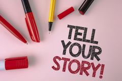 Conceptual hand writing showing Tell Your Story Motivational Call. Business photo text Share your experience motivate world writte. N plain Pink background Pens stock image