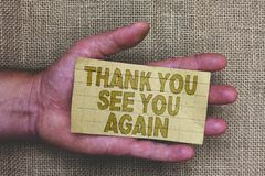 Conceptual hand writing showing Thank You See You Again. Business photo showcasing Appreciation Gratitude Thanks I will be back so. On Thick gray paper with stock photography