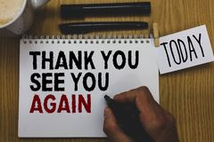 Conceptual hand writing showing Thank You See You Again. Business photo text Appreciation Gratitude Thanks I will be back soon Wri. Tten on paper hand hold pen stock photo
