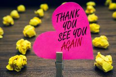 Conceptual hand writing showing Thank You See You Again. Business photo text Appreciation Gratitude Thanks I will be back soon Pap. Erclip hold pink written stock images