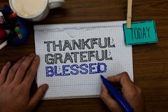 Conceptual hand writing showing Thankful Grateful Blessed. Business photo showcasing Appreciation gratitude good mood attitude Han. D hold pen paper clip written Stock Photography