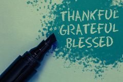 Conceptual hand writing showing Thankful Grateful Blessed. Business photo showcasing Appreciation gratitude good mood attitude Spr. Inkle blue color on floor stock photo