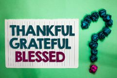 Conceptual hand writing showing Thankful Grateful Blessed. Business photo text Appreciation gratitude good mood attitude white not. Epad with words teal blue stock photo
